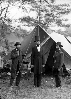 Abraham Lincoln with Allan Pinkerton and Maj. Gen. John A. McClernand photographed by Alexander Gardner at Antietam on October 3, 1862