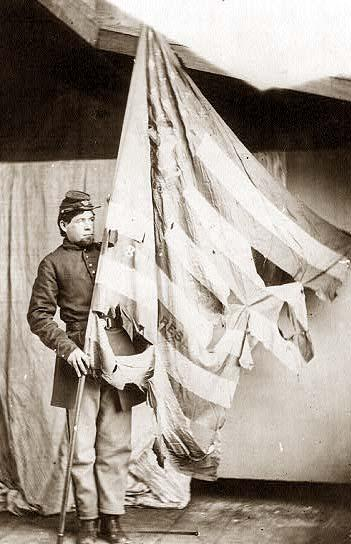 Soldier with a tattered flag circa 1864