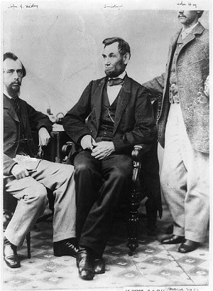 Abraham Lincoln seated between his private secretaries John G. Nicolay and John Hay photographed by Alexander Gardner in 1863