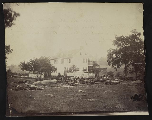 Dead horses on the ground in front of Abraham Trostle's house near the headquarters of General Daniel Edgar Sickles at Gettysburg, photographed by Timothy O'Sullivan, circa July 1863