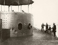 USS Monitor on the James River, Virginia, 1862 Officers on deck (left to right) Robinson W Hands, Louis N Stodder, Albert B Campbell (seated) William Flye (with binoculars)