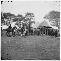 Soldiers in Fredericksburg, Va filling canteens circa 1864