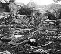 Dead Confederate soldiers in the Devil's Den at Gettsyburg, photographed by Alexander Gardner, circa July 1863