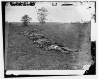 Bodies of Confederate dead gathered for burial after Battle of Antietam, photographed by Alexander Gardner. circa Sept-Oct 1862