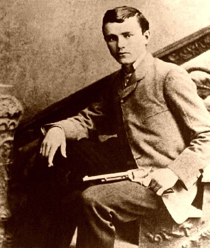 Robert Ford posing with the gun that killed Jesse James, circa 1882-1892